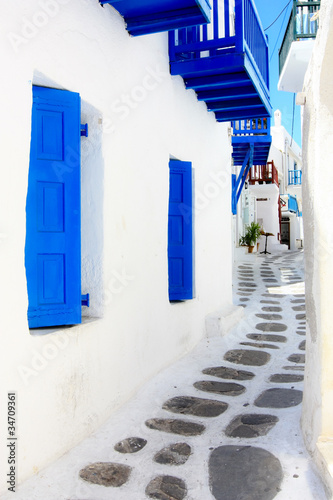 white washed narrow street in Mykonos island