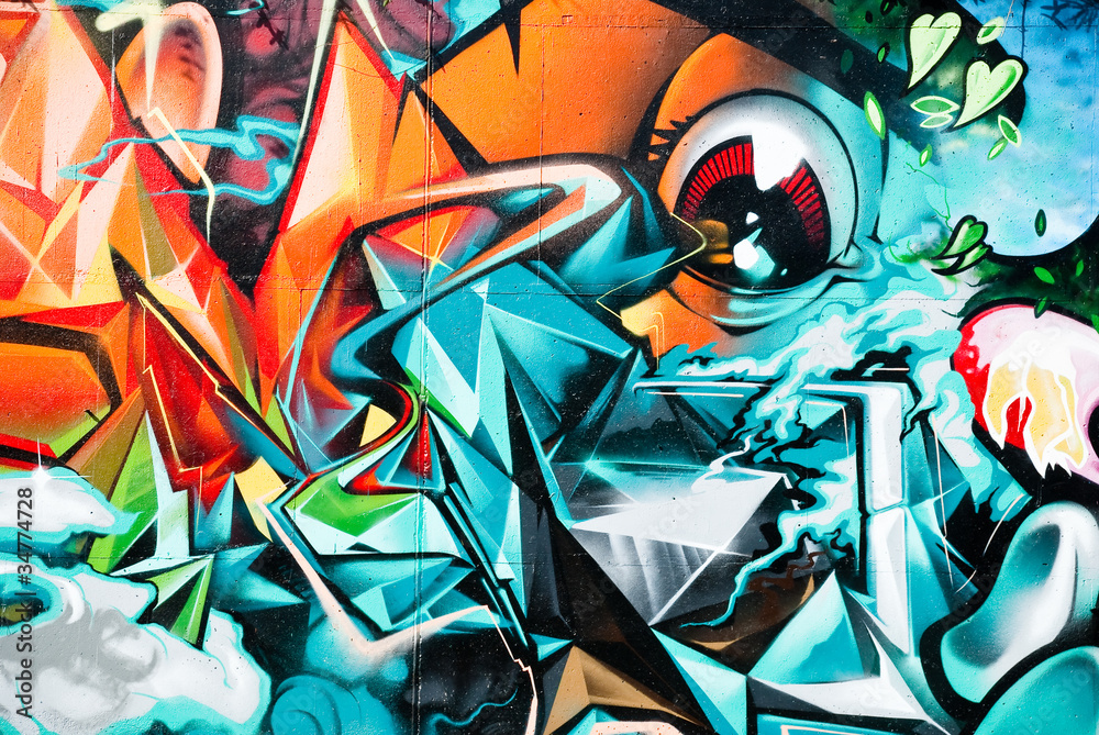 Abstract Graffiti detail on the textured wall