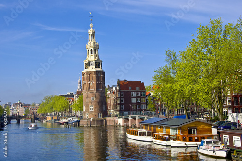 Classical Amsterdam view. Boat floats Canvas Print