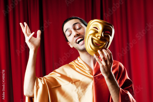 Fotografia, Obraz  Actor with maks in a funny theater concept