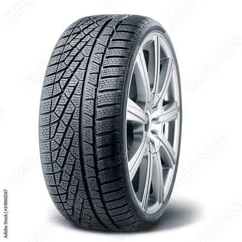 Winter tire with alurim on white background Fototapet