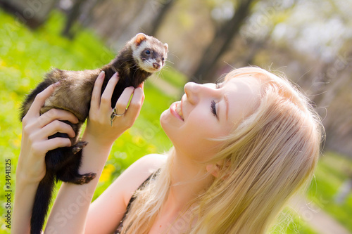 Fotografering  Girl with a polecat