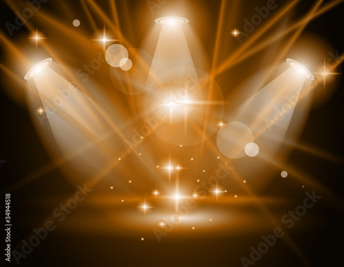 magic spotlights with gold rays and glowing effect