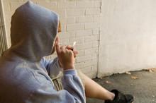 Teen Boy Lighting A Joint