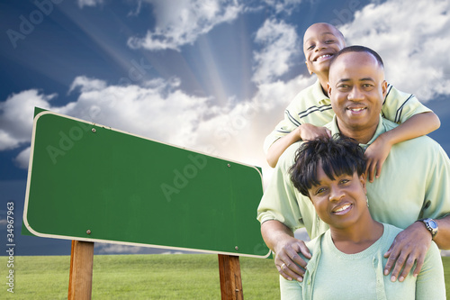 Fotografia, Obraz  African American Family in Front of Blank Green Road Sign