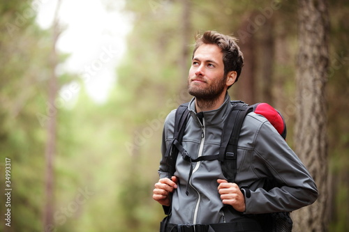 Fototapeta Hiker - man hiking in forest obraz