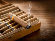 Smoking Cuban Cigar Over Box  ...
