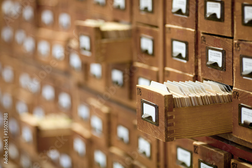 Poster Bibliotheque database concept. vintage cabinet. library card or file catalog.