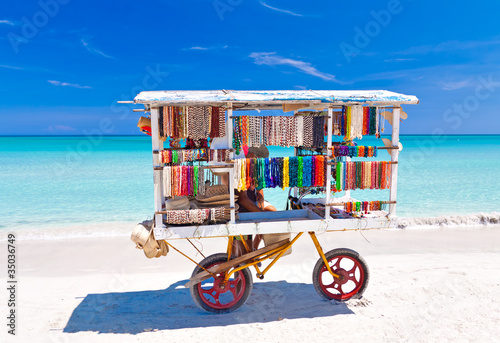 Photo Stands Caribbean Cart selling typical souvenirs on cuban beach of Varadero