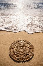 Aztec Calendar Stone Carving On Sandy Beach