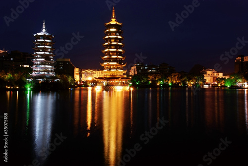 Double wooden towers in guilin of china nightscape