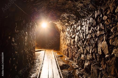 Fotografie, Obraz Mine tunnel with path - historical gold, silver, copper mine.