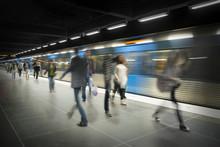 Blurred People On Subway Platf...
