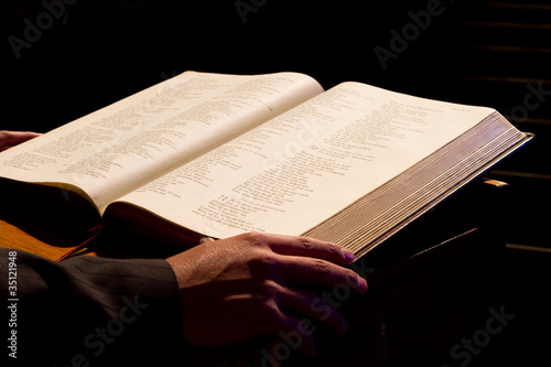 Fototapeta  Holy Bible and human hand