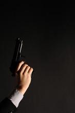 Man Hand With A Gun