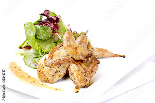 Foto op Aluminium Baobab Quail with green and purple salad
