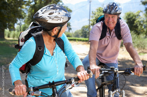 Senior couple on country bike ride Canvas-taulu