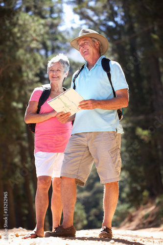 Valokuva Senior couple reading map on country walk