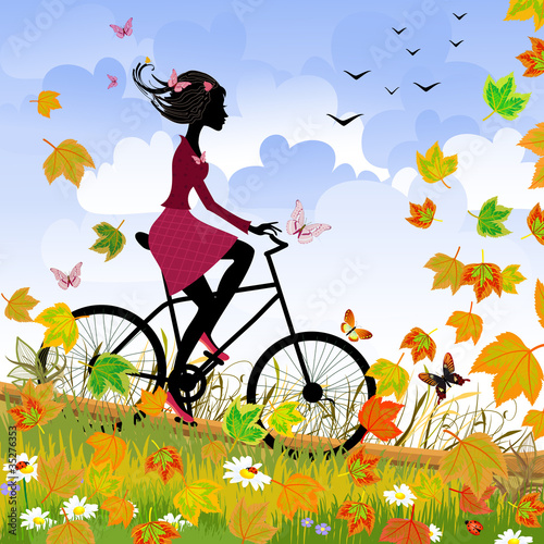 Foto op Canvas Bloemen vrouw Girl on bike outdoors in autumn