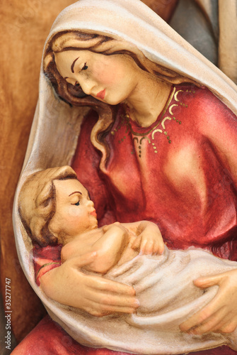 Tablou Canvas Weihnachtskrippe Holzfigur Josef und Maria mit Jesus im Arm