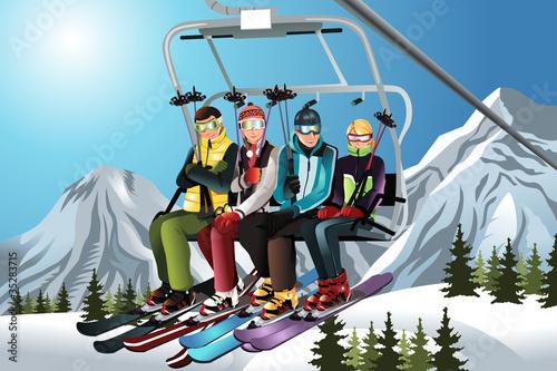 Fotografie, Obraz  Skiers on the ski lift