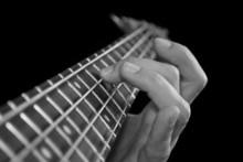 Fingers On Guitar Fretboard