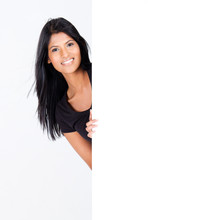 Attractive Hispanic Woman Behind Blank White Board