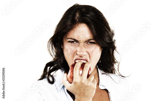 chica joven mordiendo una manzana con ganas Canvas Print