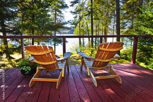 Forest cottage deck and chairs Wallpaper Mural