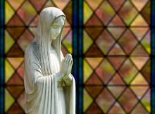 Isolated Statue Of Mary Against Window