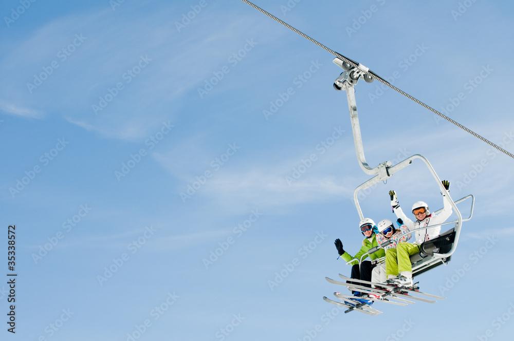 Fototapety, obrazy: Ski lift - happy skiers on ski  vacation (copy space)