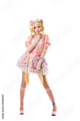 Fotografie, Obraz  Young woman in lolita costume cosplay isolated