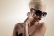 Leinwanddruck Bild blond girl with sunglasses