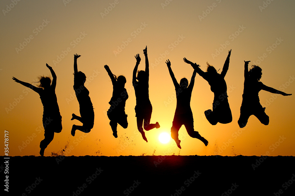Fototapety, obrazy: silhouette of friends jumping in sunset