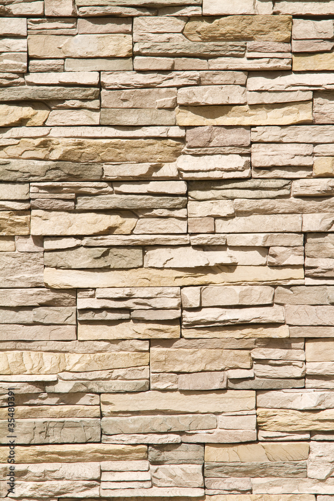 Stacked stone wall background vertical