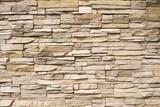 Fototapeta Kamienie - Stacked stone wall background horizontal