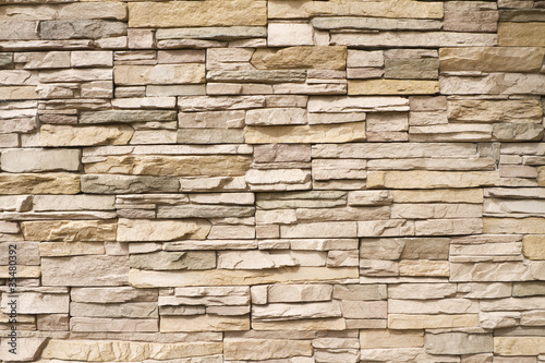 Poster Stenen Stacked stone wall background horizontal