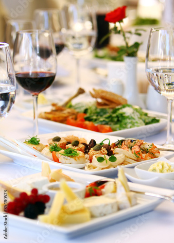 Fotografie, Obraz  Different snacks for wine on banquet table