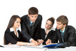 young business people sitting at desk working in team