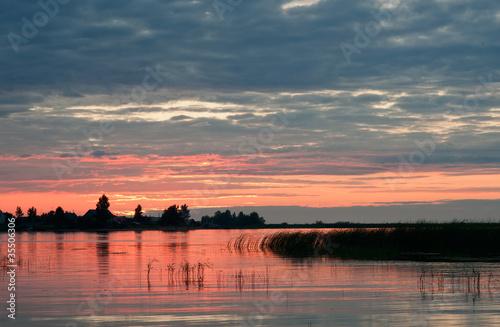 Staande foto Afrika Sunset on the Volkhov River.