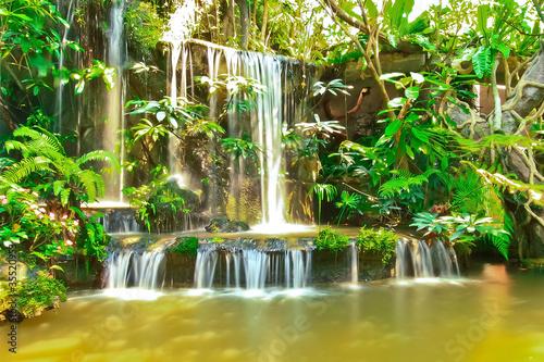 Beautiful tropical man-made garden waterfalls
