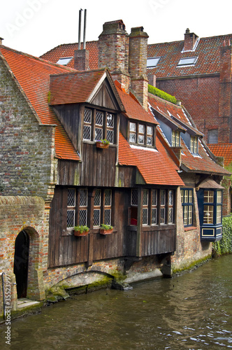 Photo  Classic view of channels of Bruges. Belgium.