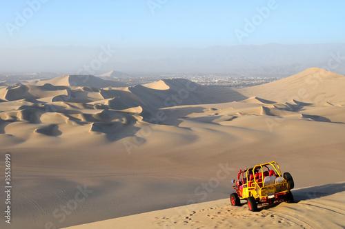 Fotobehang Zandwoestijn Sand Dessert with Dune Buggy