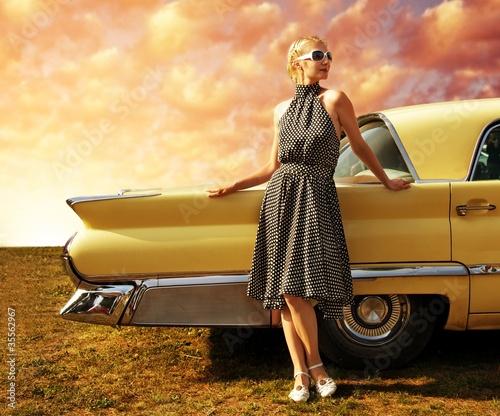 Fototapeta na wymiar Beautiful lady standing near retro car.