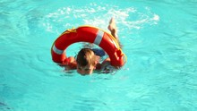 Boy Swimming In The Pool Water
