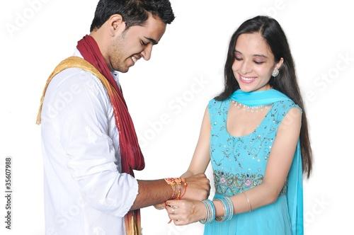 Photo  Sister tying Rakhi on her brother's wrist on Rakshabandhan