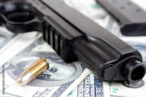 Fotografie, Tablou  9mm bullet and handgun with money