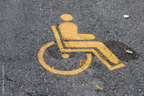 Valokuva  yellow road marking for disabled and invalid parking