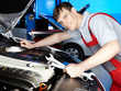Motor mechanic is fixing the engine of a car carfully