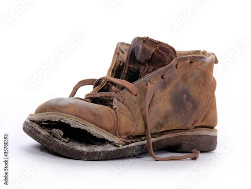 Fotografia  Old boot over white